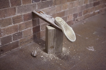 Planking, 2011, wood, oyster shell, sand, concrete and sandshoe sole, dimensions variable